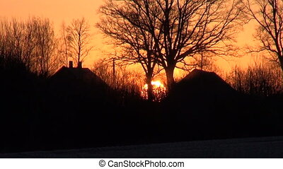 beautiful winter time sunrise in village