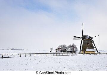 Beautiful winter windmill landscape