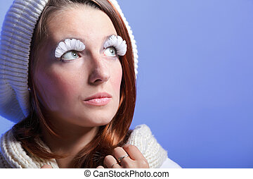 Beautiful winter young woman portrait with white eye-lashes