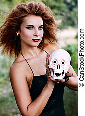 witch holding a human skull