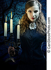 witch in a gothic dress