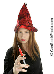 beautiful witch portrait with red syringe