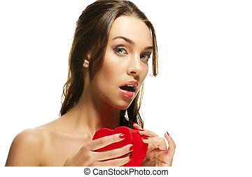 beautiful woman about to open a red heart shaped box on white background