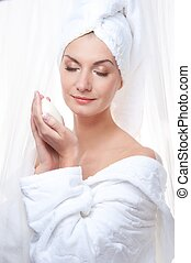 Beautiful woman after shower holding a soap