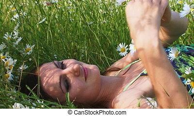 Beautiful woman among flowers
