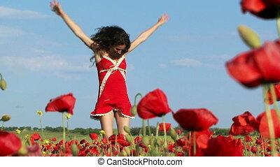 Beautiful woman among poppies