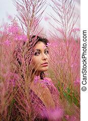 Beautiful Woman Amongst The Flowers