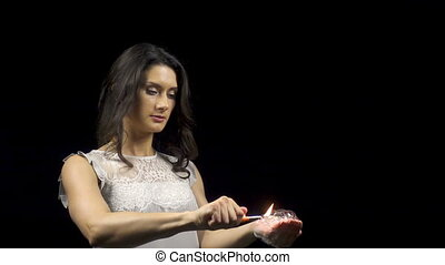 Beautiful woman and burning soap bubbles