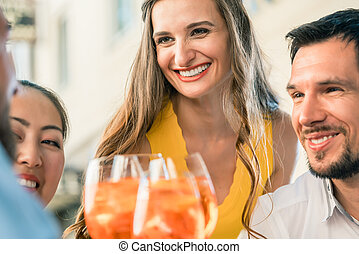 Beautiful woman and her best friends toasting with a refreshing drink