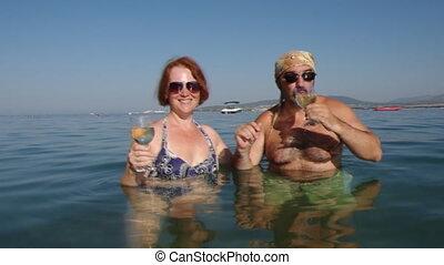 Beautiful  woman  and man  drinks
