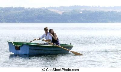 beautiful woman and man on a lake