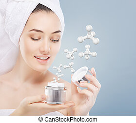 applying cosmetic cream - beautiful woman applying cosmetic ...