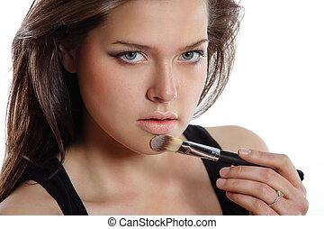 beautiful woman applying cosmetic. Make-up