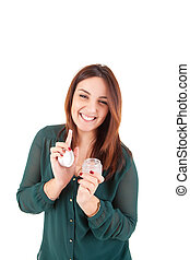 Beautiful woman applying moisturizer over white background