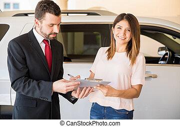 Beautiful woman at a car dealership