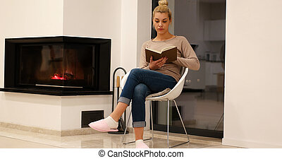 beautiful woman at home reading book