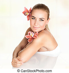 Beautiful woman at spa salon