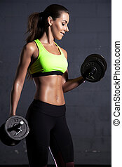beautiful woman at the gym - Portait of young adult sporty ...