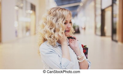 beautiful woman at the mall talking on the phone