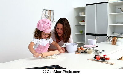 Beautiful woman baking with her daughter