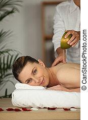 beautiful woman being massaged