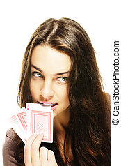 beautiful woman bites in a poker card on white background