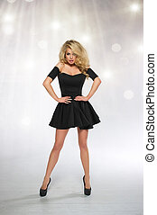 Beautiful Woman Blonde Fashion Model in black dress isolated on white