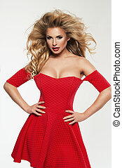 Beautiful Woman Blonde Fashion Model in red dress isolated on white