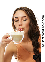 beautiful woman blow to her hot cappuccino on white background
