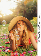 Beautiful Woman Blowing Bubbles - Beautiful Young Woman...