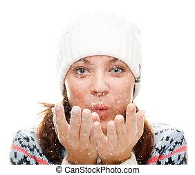 Beautiful woman blowing snow