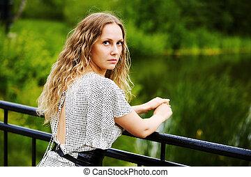 Beautiful woman by the lake