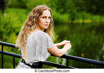 Beautiful woman by the lake