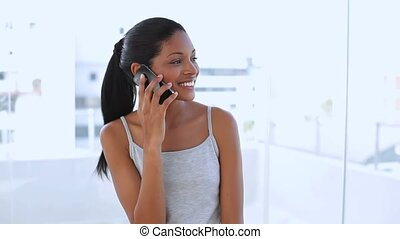 Beautiful woman calling someone with her mobile phone in...