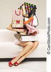 Beautiful woman carrying plenty of shopping bags - Beautiful...