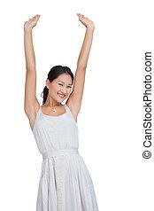 Beautiful woman cheering and looking at camera
