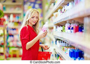 beautiful woman choosing personal care product in ...