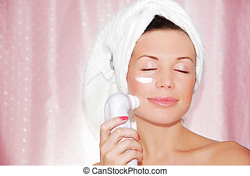 beautiful woman cleaning face