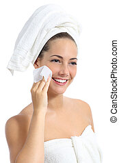 Beautiful woman cleaning her face with a baby wipe isolated...