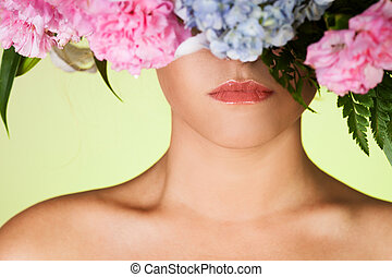 Beautiful woman close-up portrait and flower wreath