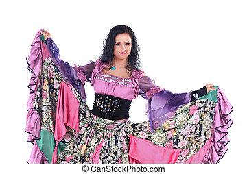 beautiful woman dancer in a Gypsy costume