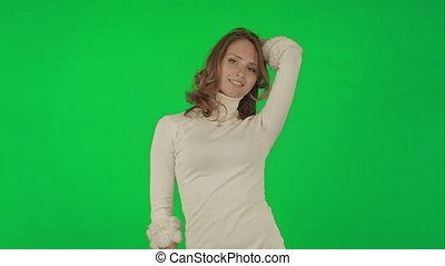 Beautiful woman dances on a Green Screen Chrome Key