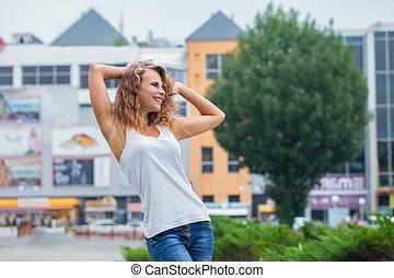 Beautiful woman dances on the street
