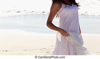 Beautiful woman dancing and twirling her scarf on the sunny...