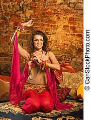 Beautiful woman dancing on a pillows