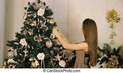 Beautiful woman decorate Christmas tree