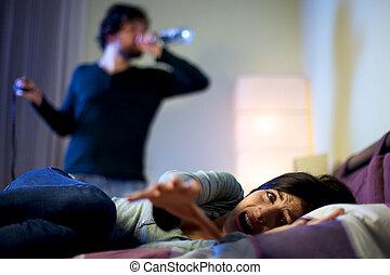 Beautiful woman depressed screaming about drunk husband drinking
