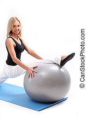 Beautiful woman doing exercise with fitness ball