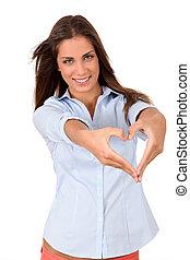 Beautiful woman doing heartshape with hands