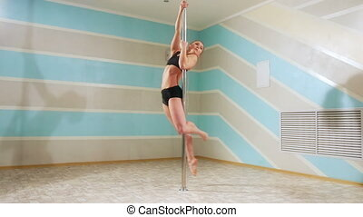 Beautiful woman doing pole dance, female dancer, girl dancing, fitness and sport
